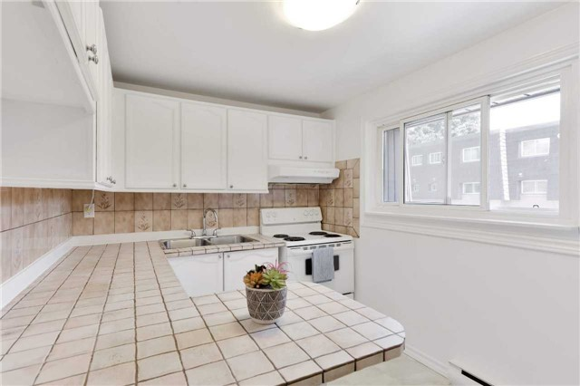 For Sale: 105 Darras Court, Brampton, ON | 4 Bed, 2 Bath Condo for $439,900. See 19 photos!