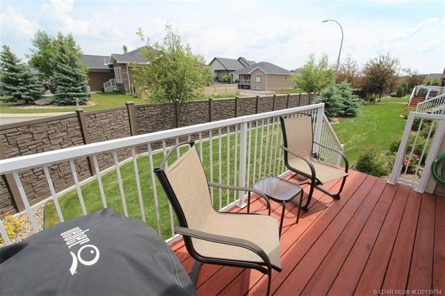 For Sale: 414 Couleecreek Boulevard South, Lethbridge, AB   3 Bed, 3 Bath Townhouse for $339,900. See 30 photos!