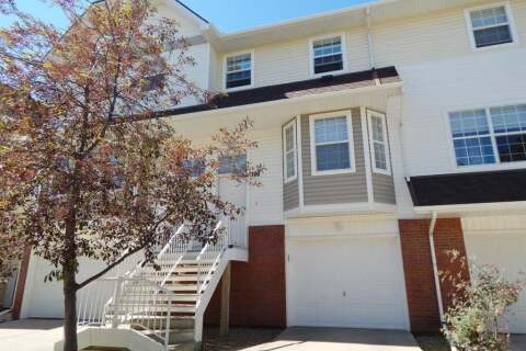Townhouse for sale at 100 Tuscany Springs Gdns NW Calgary Alberta - MLS: A1012692