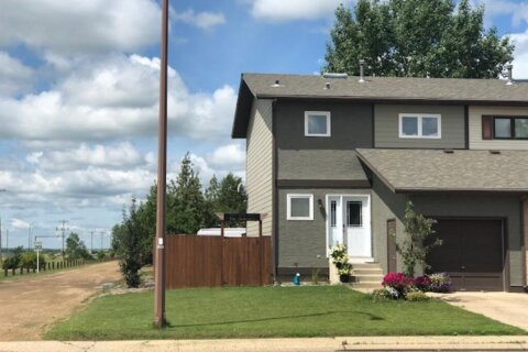 Townhouse for sale at 1001 3rd St Hanna Alberta - MLS: A1012902