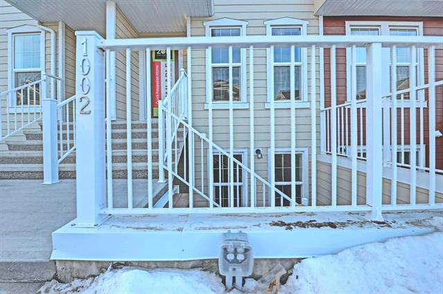For Sale: 1002 - 2400 Ravenswood View Southeast, Airdrie, AB | 2 Bed, 2 Bath Townhouse for $215,900. See 27 photos!