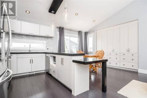 House for sale at 1003 Hargreaves Mnr  Saskatoon Saskatchewan - MLS: SK763911