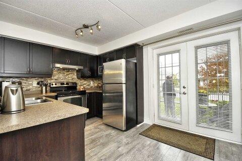 Condo for sale at 1340 Main St Unit 101 Milton Ontario - MLS: W4970455