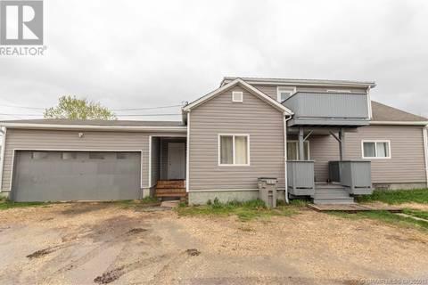 House for sale at 10112 104 Ave Grande Prairie Alberta - MLS: GP205012