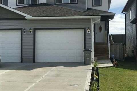 Townhouse for sale at 10121 84a Street  Grande Prairie Alberta - MLS: A1031318