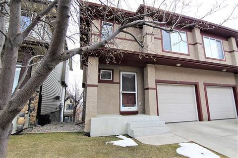Townhouse for sale at 102 Hidden Creek Ri Northwest Calgary Alberta - MLS: C4242346