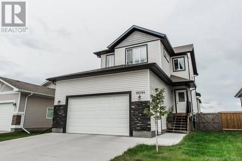 House for sale at 10204 125 Ave Grande Prairie Alberta - MLS: GP207346