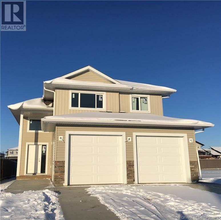 Townhouse for sale at 10210 126 Ave Grande Prairie Alberta - MLS: GP208688