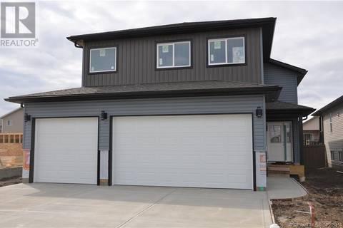 House for sale at 10217 126 Ave Grande Prairie Alberta - MLS: GP205454
