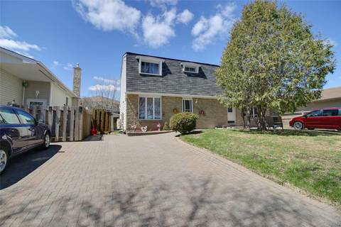 Townhouse for sale at 1023 Woodbine Ave Out Of Area Ontario - MLS: X4450038