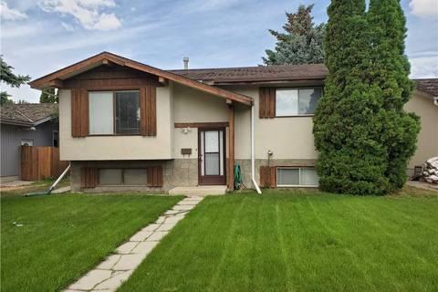 House for sale at 1027 Lakemount Blvd W Lethbridge Alberta - MLS: LD0173044