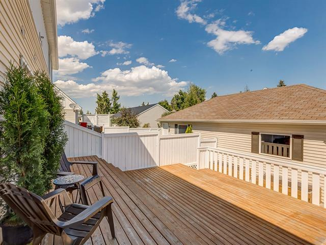 For Sale: 103 Amiens Crescent Southwest, Calgary, AB   4 Bed, 1 Bath Townhouse for $559,900. See 28 photos!