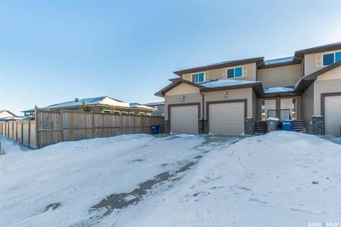 Townhouse for sale at 103 Plains Circ Pilot Butte Saskatchewan - MLS: SK757510