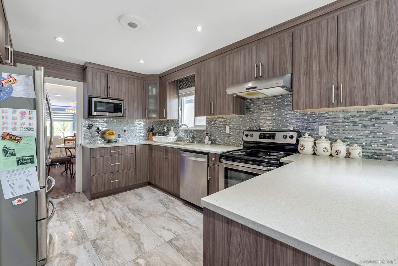 For Sale: 1032 East 61st Avenue, Vancouver, BC | 4 Bed, 5 Bath House for $1,698,000. See 20 photos!