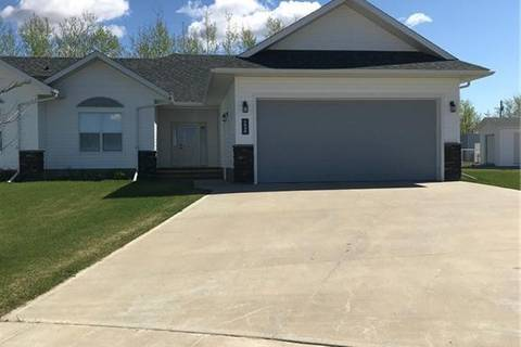 Townhouse for sale at 1036 10b Street  Beaverlodge Alberta - MLS: GP205423