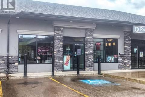Commercial property for sale at 9215 Lakeland Dr Unit 104 Grande Prairie Alberta - MLS: GP205904