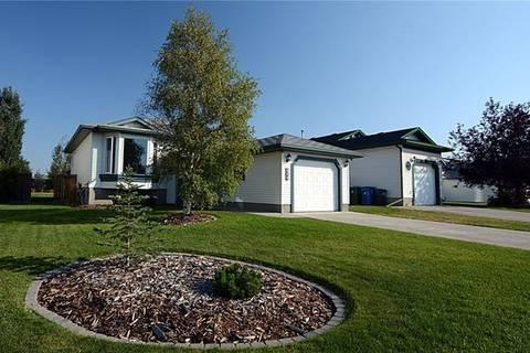 House for sale at 104 West Mcdougal Rd Cochrane Alberta - MLS: C4233101
