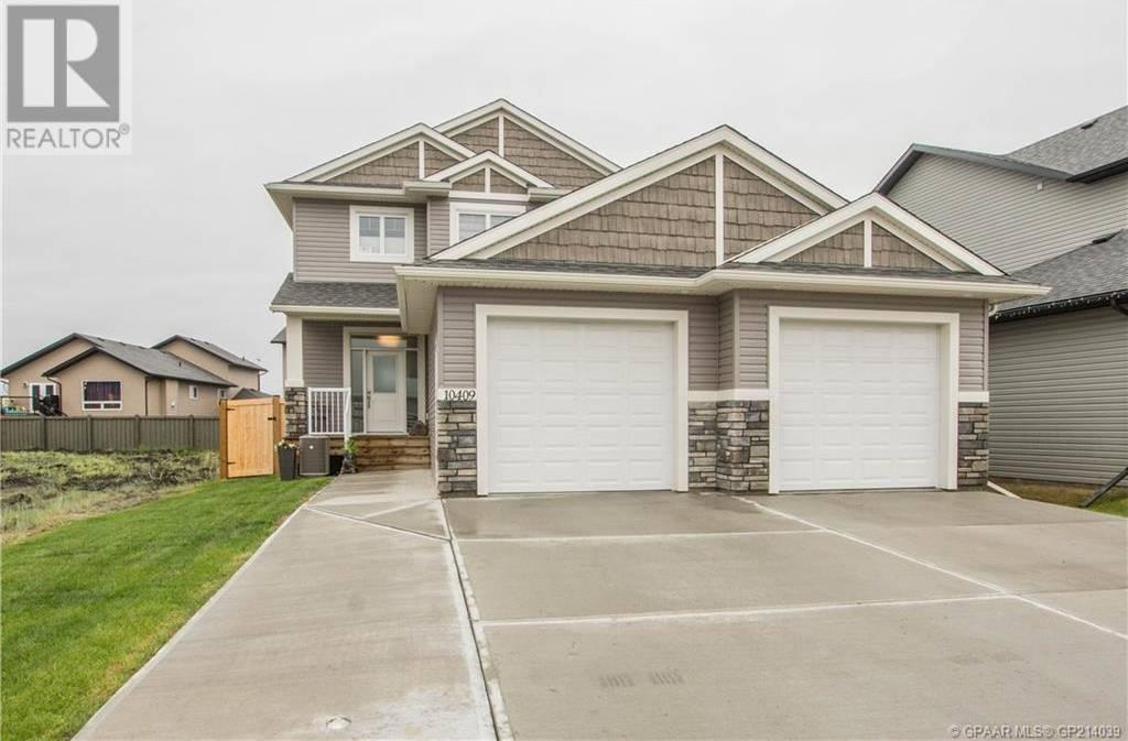 House for sale at 10409 129 Ave Grande Prairie Alberta - MLS: GP214039