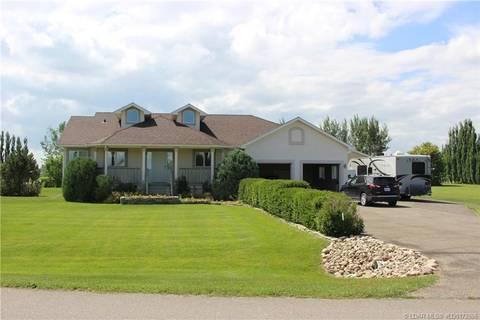 Home for sale at 106 Bona Vista Dr Rural Lethbridge County Alberta - MLS: LD0172896