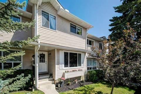 Townhouse for sale at 106 Woodsman Ln Southwest Calgary Alberta - MLS: C4258160