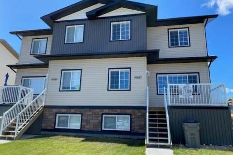 Townhouse for sale at 10612 114b St Grande Prairie Alberta - MLS: A1000587