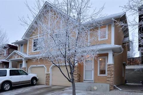 Townhouse for sale at 107 Hidden Creek Ri Northwest Calgary Alberta - MLS: C4243179