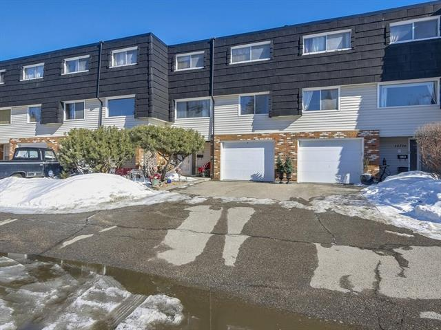 For Sale: 10712 Braeside Drive Southwest, Calgary, AB | 3 Bed, 2 Bath Townhouse for $300,000. See 16 photos!