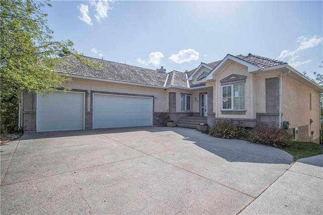 For Sale: 109 Cove Landing, Chestermere, AB | 4 Bed, 3 Bath House for $950,000. See 14 photos!