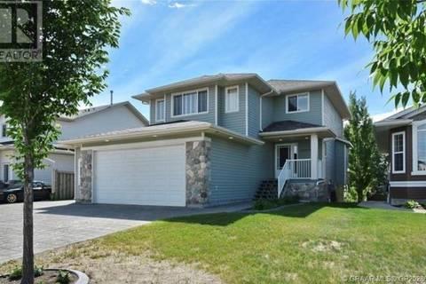 House for sale at 10909 65 Ave Grande Prairie Alberta - MLS: GP202860