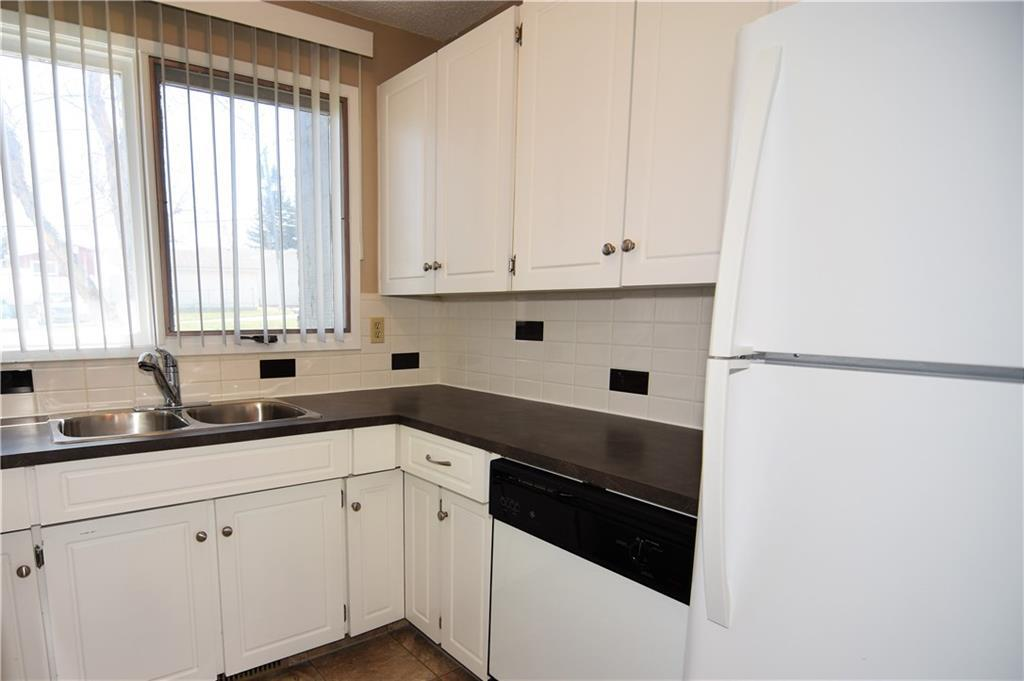 For Sale: 11 - 6440 4 Street Northwest, Calgary, AB   2 Bed, 1 Bath Townhouse for $224,900. See 23 photos!