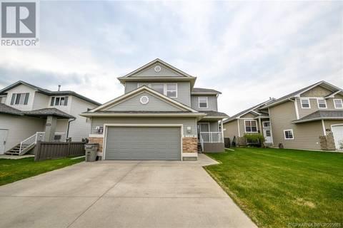 House for sale at 11033 66 Ave Unit 66 Grande Prairie Alberta - MLS: GP205663