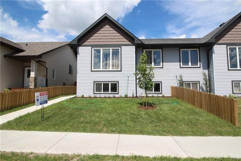 Townhouse for sale at 1108 Limit Ave Crossfield Alberta - MLS: C4219397