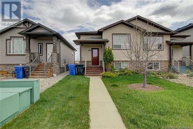 Townhouse for sale at 111 Mt Sundance Cres West Lethbridge Alberta - MLS: ld0193531