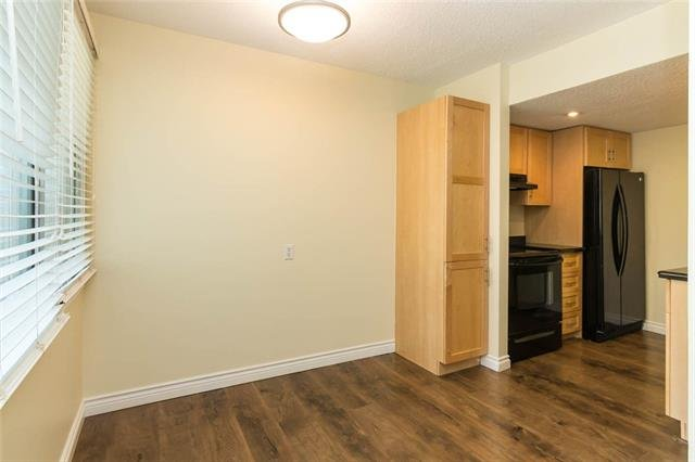 For Sale: 112 - 1055 72 Avenue Northwest, Calgary, AB | 2 Bed, 1 Bath Townhouse for $214,000. See 30 photos!