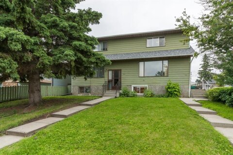 Townhouse for sale at 1121 35th St SE Calgary Alberta - MLS: A1017431