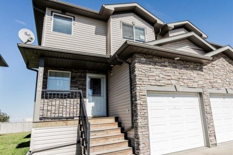 Townhouse for sale at 11218 71 Ave Grande Prairie Alberta - MLS: A1031843