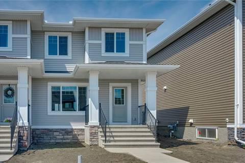Townhouse for sale at 113 Heartland Blvd Cochrane Alberta - MLS: C4244820