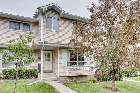Townhouse for sale at 113 Woodsman Ln Southwest Calgary Alberta - MLS: C4259264