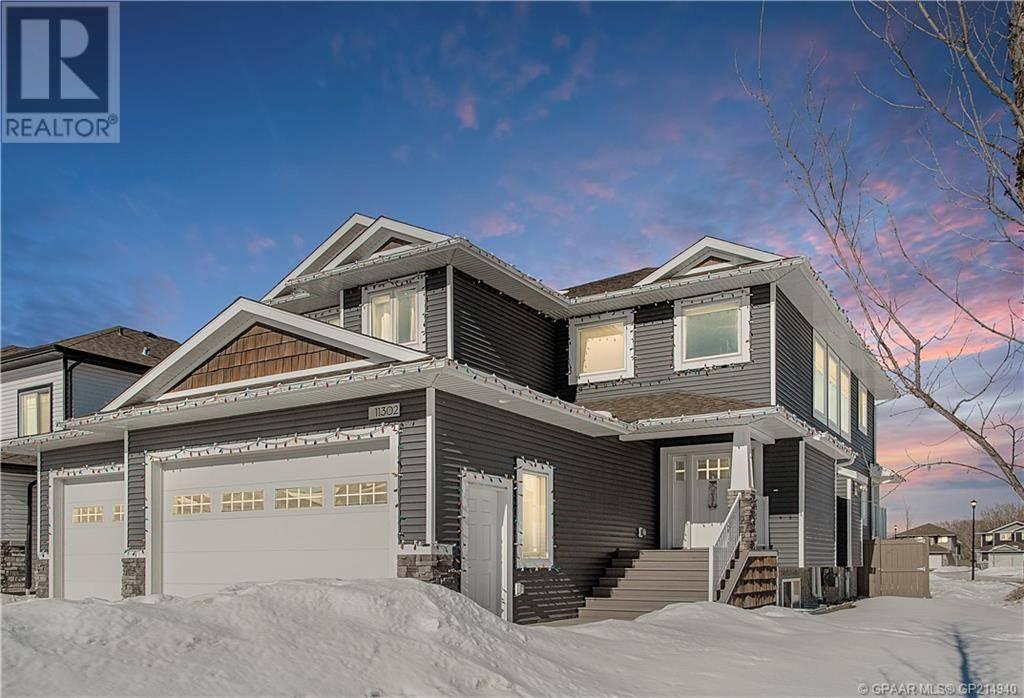 House for sale at 11302 59 Avenue Court Grande Prairie Alberta - MLS: GP214940