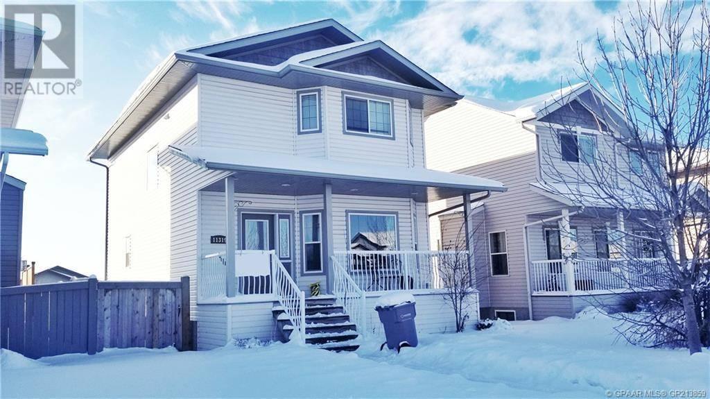 House for sale at 11319 Pinnacle Dr Grande Prairie Alberta - MLS: GP213859