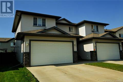 House for sale at 11341 82 Ave Grande Prairie Alberta - MLS: GP207650