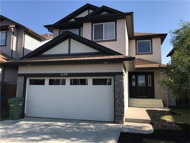 Sold: 1139 Prairie Springs Hills Southwest, Airdrie, AB