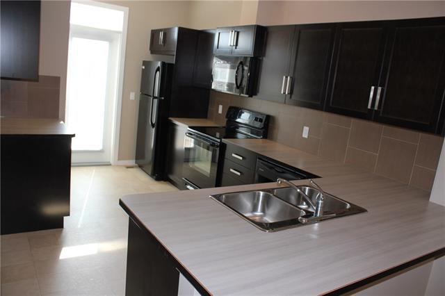For Sale: 114 New Brighton Landing Southeast, Calgary, AB | 2 Bed, 2 Bath Townhouse for $294,900. See 21 photos!
