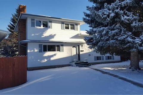 11411 Southdale Close Southwest, Calgary | Image 1