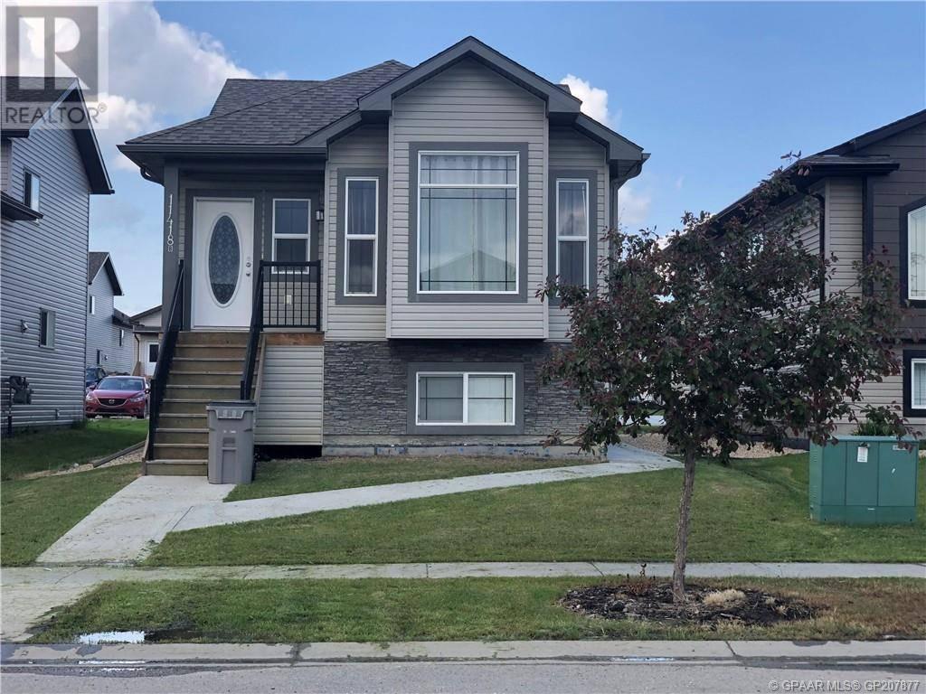Townhouse for sale at 11418 73 Ave Grande Prairie Alberta - MLS: GP207877