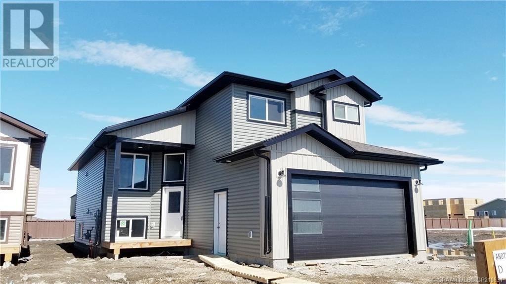 House for sale at 11418 Wisteria Ct Grande Prairie Alberta - MLS: GP210631