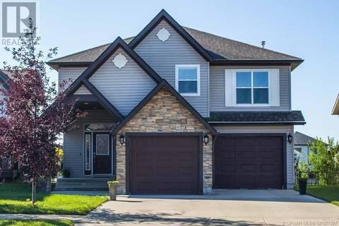 House for sale at 11437 Pinnacle Dr Grande Prairie Alberta - MLS: GP207327