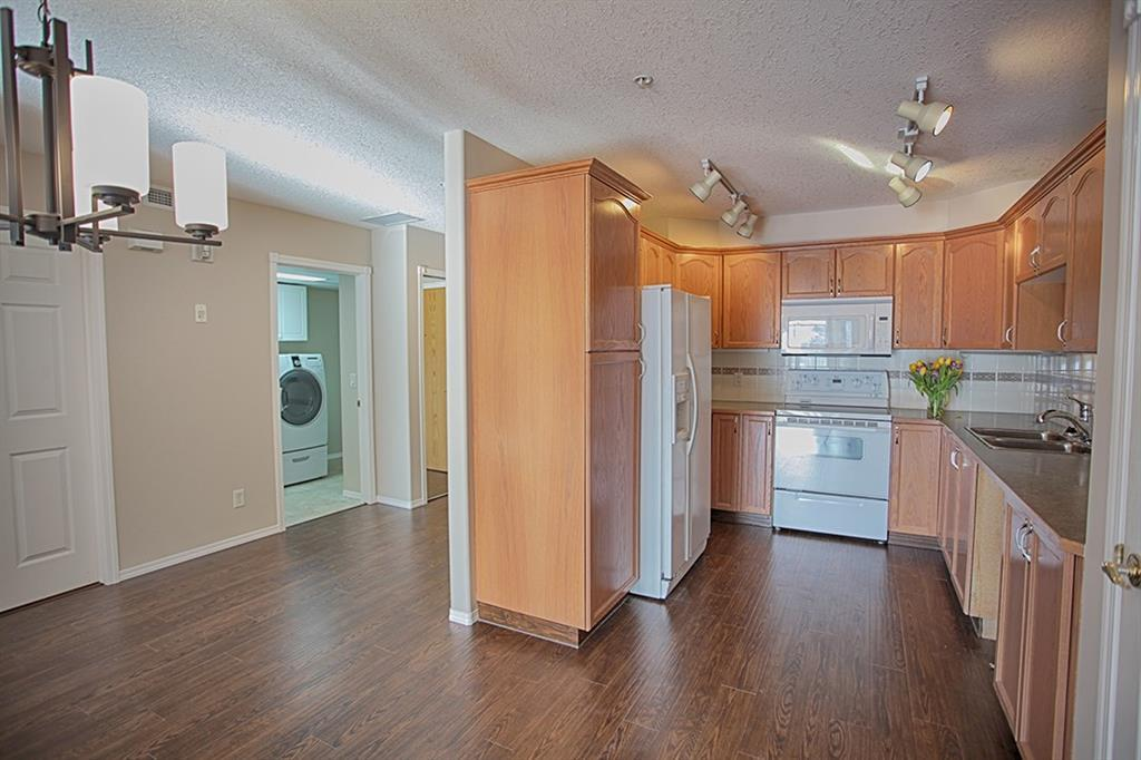 For Sale: 116 - 728 Country Hills Road Northwest, Calgary, AB | 2 Bed, 2 Bath Condo for $329,900. See 23 photos!