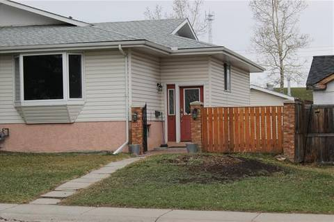 Townhouse for sale at 11736 Canfield Rd Southwest Calgary Alberta - MLS: C4228762