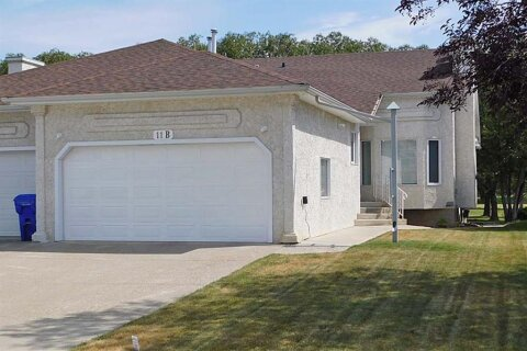 Townhouse for sale at 11 Westlynn Dr W Claresholm Alberta - MLS: A1037511
